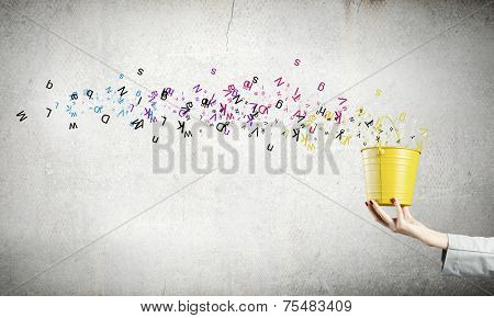 Close up of woman hand holding bucket