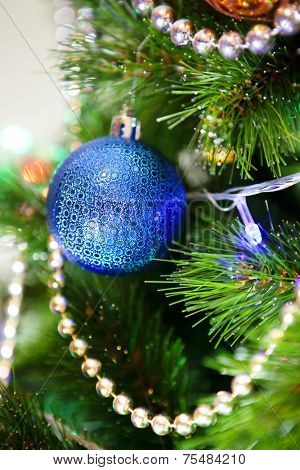 blue ball on a green New Year tree