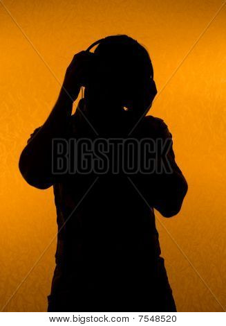 Music Fan. Silhouette Of Man With Earphones
