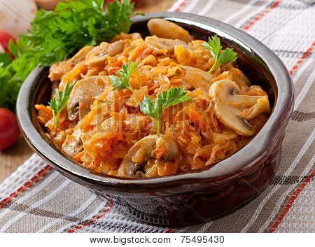 Stewed cabbage with mushrooms and tomato sauce