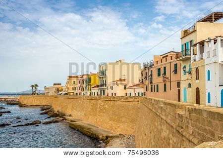 City Wall With Colored Houses In Alghero