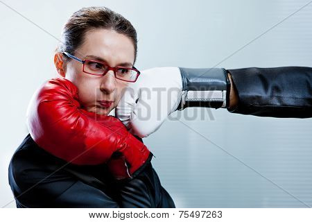 Box Glove Hitting The Face Of A Business Woman