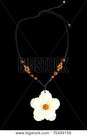 Necklace with Flower and Orange Beads, on Black String, Isolated on Black Background