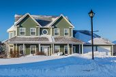 stock photo of model home  - A typical north American family home after a snow storm - JPG