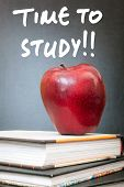 stock photo of time study  - Apple on books and time to study handwritten on the chalkboard in the background - JPG