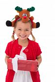 stock photo of rudolph  - Cute little girl wearing rudolph headband on white background - JPG
