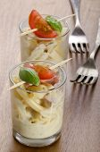 pic of carbonara  - macaroni carbonara with tomato and basil in a shot glass - JPG