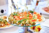stock photo of catering service  - catering table set service with silverware and glass stemware at restaurant before party - JPG