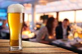 picture of weeping  - Photo of cold beer glass on the bar table - JPG