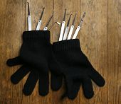 picture of pick-lock  - Lock picks with gloves on wooden table - JPG