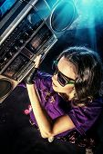 foto of rap-girl  - Portrait of a modern girl with tape recorder over grunge background - JPG