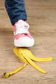 stock photo of slip hazard  - Shoe to slip on banana peel and have an accident - JPG