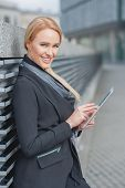 picture of louvers  - Stylish businesswoman using a tablet - JPG