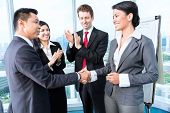 stock photo of applause  - Asian Business Team  - JPG