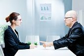 pic of politeness  - business man and business woman discussing facing each other in a polite discussion - JPG