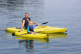 image of kayak  - Family Kayaking together on a beautiful lake - JPG