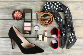 stock photo of cosmetology  - Essentials fashion woman objects on wooden background - JPG
