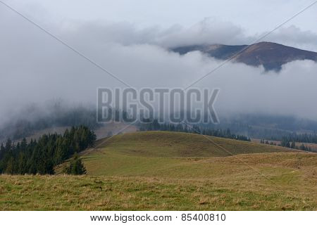 Autumn landscape. Low clouds in the mountains. Beauty in nature