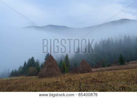 Autumn landscape. Haystacks in a mountain village. Beautiful landscape