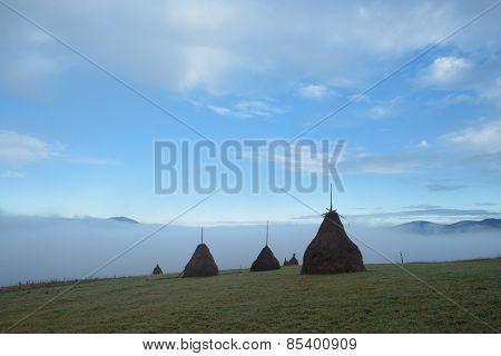 Autumn landscape. Haystack in a mountain village