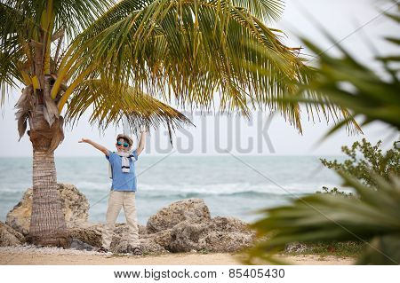 Cheerful little boy having relax outdoors