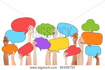 People Holding Multicolored Speech Bubbles and Cloud Symbols Concept