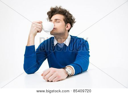 Businessman sitting at the table and drink coffee