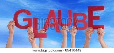 People Holding German Word Glaube Means Belief Blue Sky