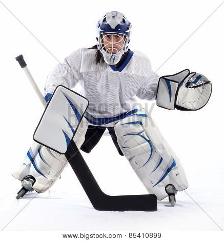 Young female ball hockey goalie