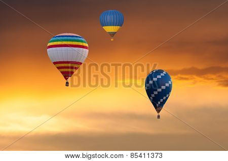 Three Hot Air Balloons in Flight on sunset sky background. Festival of colored balloons. Outdoor, Co