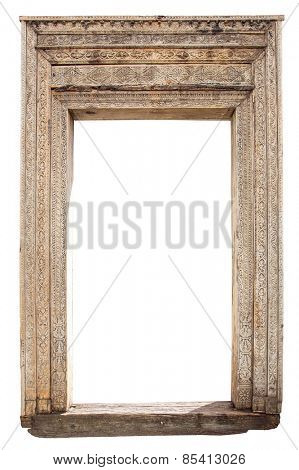 Old weathered carved wooden door frame isolated on white