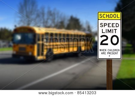 School zone speed limit sign with bus