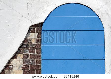 Old wooden blue gateway