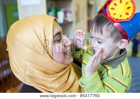 Little cute baby boy hugging and kissing his mother