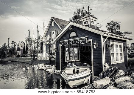 Boat House beside the river in grunge retro style