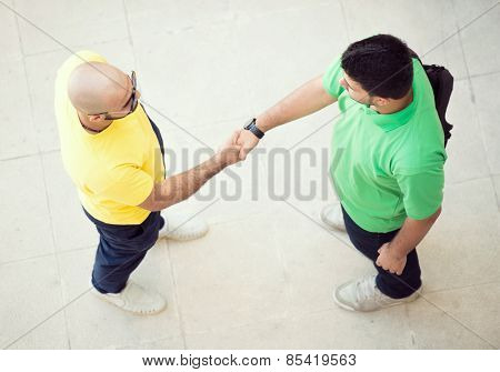 Two young man hand shaking