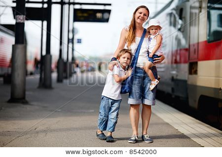 Mother And Two Kids Waiting For Train
