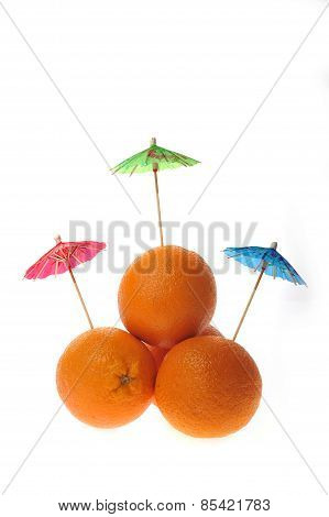 Oranges With Coctail Umbrellas Isolated On White