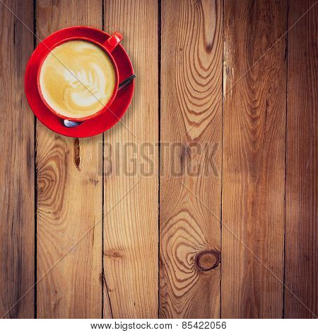 Red Cup And Latte Coffee On Wood Table With Space.