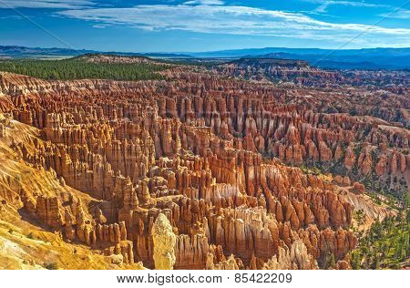 Aerial View Of Rows Sandstone Pinnacles And Brown Cliffs Of Bryce Canyon National Park Seen From Sun