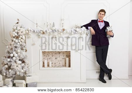Young man holding gift box