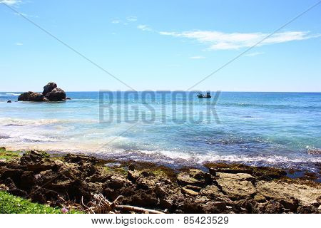 Motor boat near the shore of the Indian ocean
