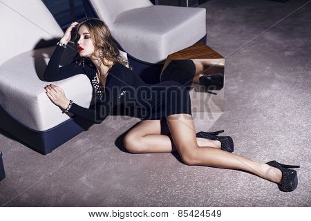 Beautiful Young Woman With Dark Hair In Elegant Black Dress