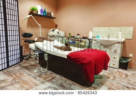 Beauty salon interior. Relaxing, zen design with table for treatment and massage