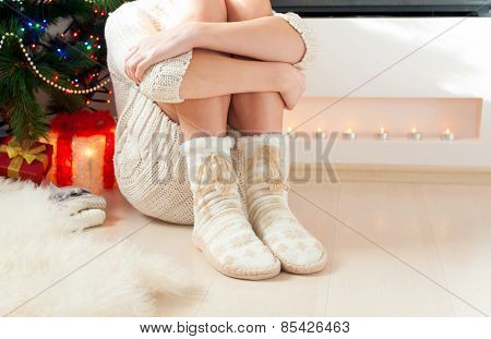 Young Girl Legs In Cozy Warm Woolen Socks With Pompons