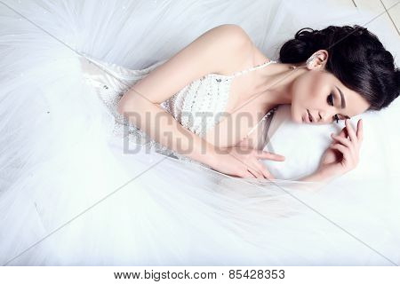 Elegant Bride With Dark Hair In Luxurious Wedding Dress