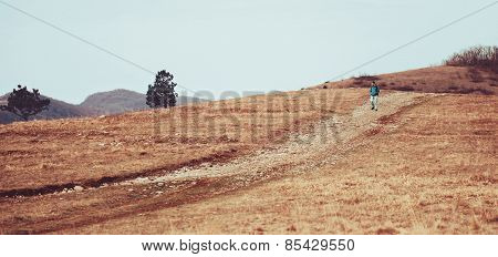 Man Walking Down On The Hill