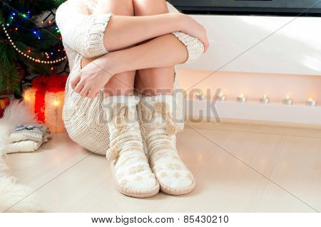 Teenage Girl Legs In Cozy Warm Woolen Socks With Pompons.