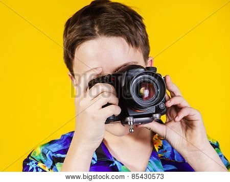 Teenage Boy Posing With Photo Camera