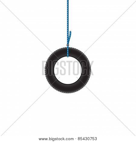 Car tire hanging on blue rope